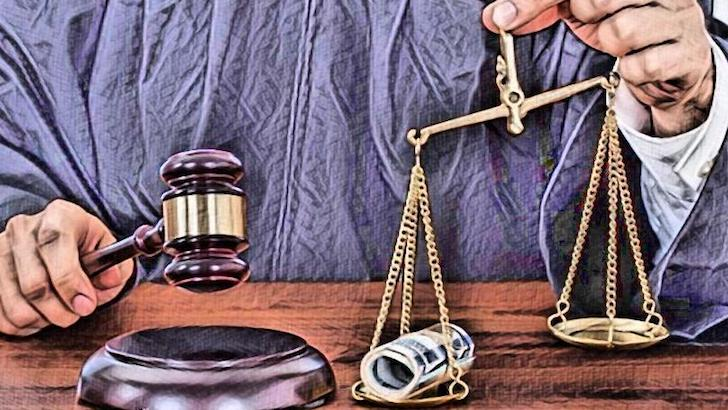 Money tips the scales of justice image