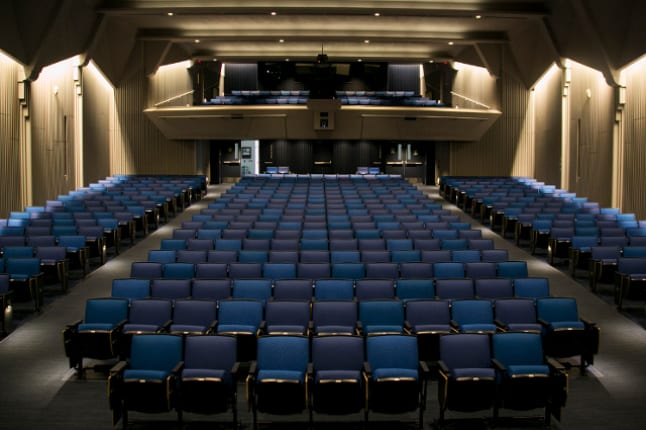 An empty Cohen Auditorium at Tufts University. Photo by Kevin Ma, courtesy of Tufts Now.
